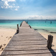 Wooden pier on tropical beach, Cancun