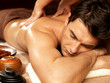canvas print picture - Man having back massage in the spa salon