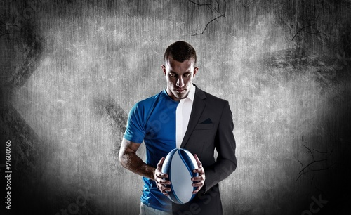 Cuadros en Lienzo Composite image of rugby player holding ball