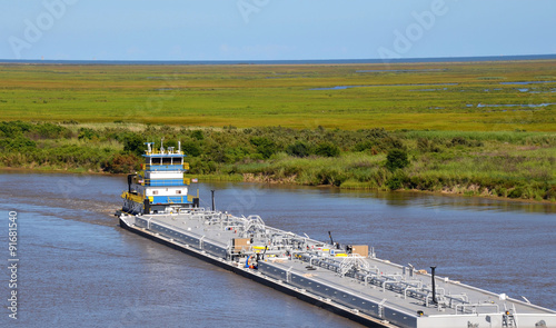 Fotografia  Oil barge being pushed by a tugboat