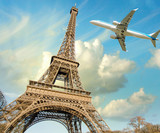 Fototapeta Wieża Eiffla - Airplane overflying Eiffel Tower in Paris
