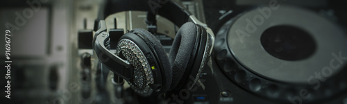Photo  Mixer console and headphones
