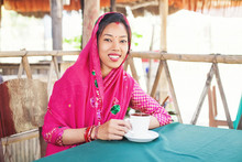 Nepali Woman Drinking Coffee Or Tea
