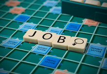 The Word 'JOB' Is Made Of The Scrabble Tiles. Scrabble Game Board As A Background.
