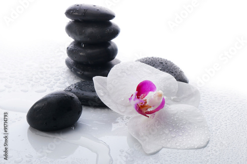 White Orchid and spa stones on a white background - 91714793