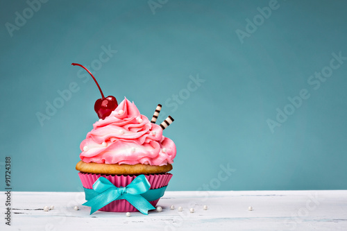 Photo  Vintage Cupcake with Cherry on Top