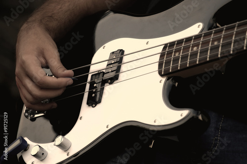 Fototapety, obrazy: A musician playing electric guitar on concert