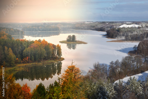 Lake Jedzelwo in autumn  and winter. Composition fifty fifty. Masuria, Stare Juchy, Poland.
