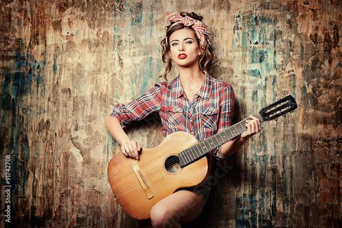 Stampa su Tela pin-up with guitar