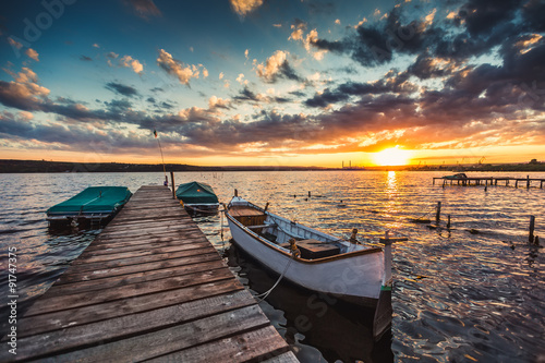 Fototapety, obrazy: Peaceful sunset with dramatic sky and boats and a jetty