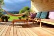 Leinwandbild Motiv Terrasse mit Möbeln und Hängematte