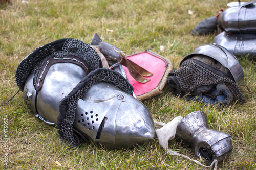 Photo  armour: helms, gauntlet, shield on the ground
