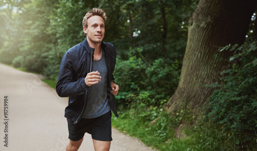 Poster Jogging Healthy Man in Jacket Jogging at the Park