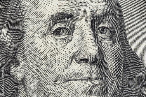 Fotografia, Obraz  Benjamin Franklin's face on the US 100 dollar bill