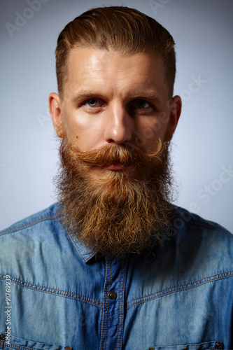 Fotografie, Obraz  Bearded man. Handsome man with a beard and twirled mustache.