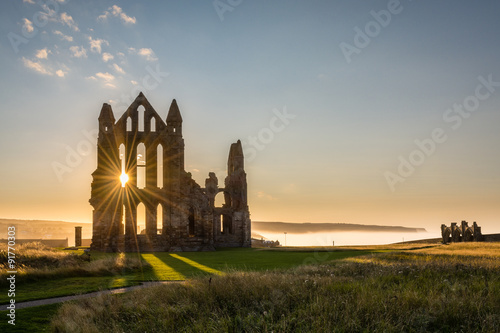 Staande foto Donkergrijs Sun Star on Whitby Abbey
