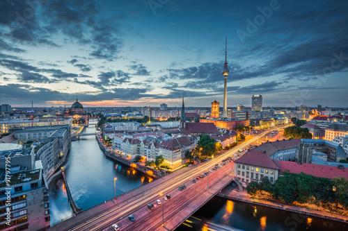 Staande foto Berlijn Berlin skyline with dramatic clouds in twilight at dusk, Germany