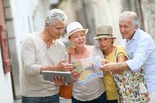 Group Of Senior People Traveli...