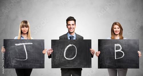 Fotografia  People holding blackboards with the word Job written on