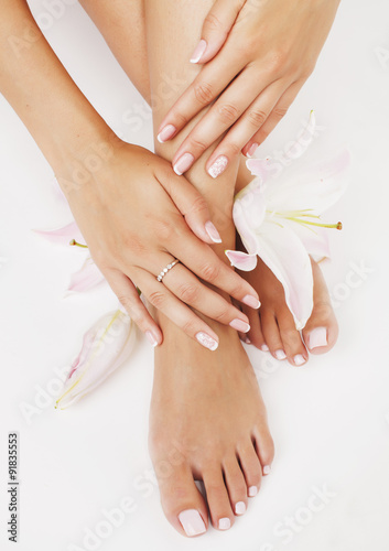 Spoed Foto op Canvas Pedicure manicure pedicure with flower lily close up isolated on white