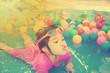 Baby girl playing in kiddie pool - vintage effect