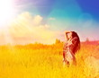 Free Happy Woman Enjoying Nature. Beauty Girl Outdoor. Sun and Sky.