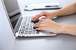 Close up of business woman hands typing on laptop computer