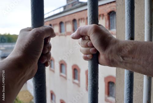 Hands on a prison window - Hände am Gefängnisfenster Fototapeta