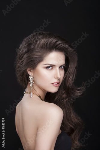 portrait of a beautiful brunette girl with luxury accessories