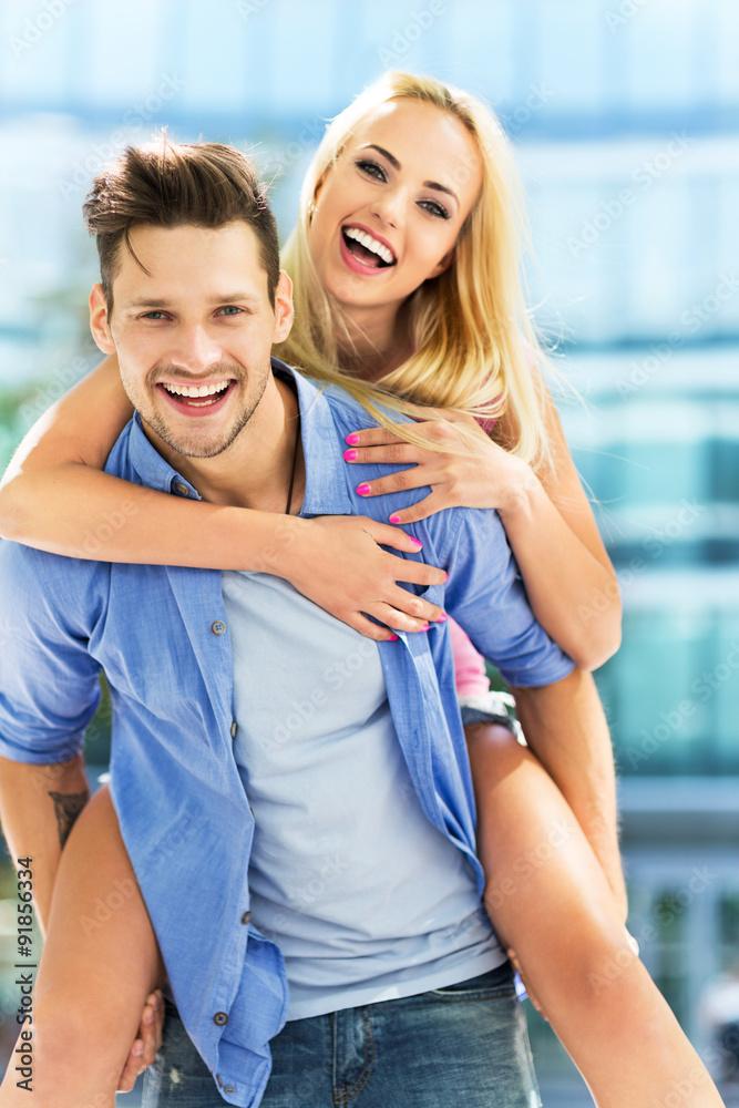 Fototapeta Young couple having fun
