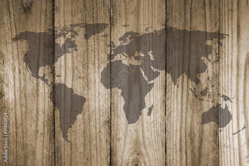 Tuinposter Wereldkaart world map on wooden texture