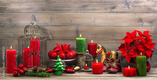 vintage christmas decorations with red flower poinsettia - 91886925