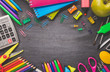 Colorful stationery on blackboard