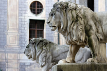 Lion Statue. Stone Monuments Of Lions In Odeon Square In Munich, Bavaria, Germany.