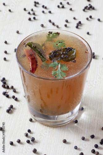 Foto op Plexiglas Chocolade Pepper Rasam from South India.