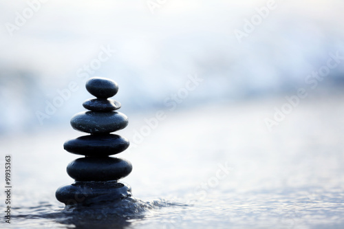 Photo Stands Zen Spa stones on sea beach outdoors