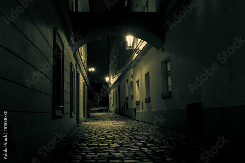 Fototapeten Schmale Gasse mysterious alley with lanterns in Prague at night