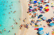 Beach, famous Tropea beach, Calabria. Crowded beach with umbrellas top view.