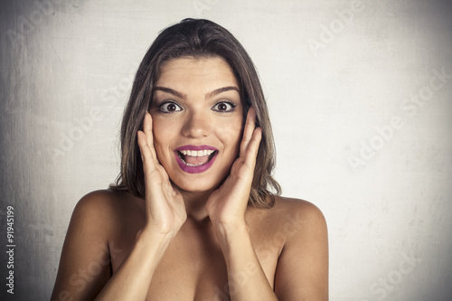 Fototapety, obrazy: Beautiful woman with surprised expression