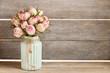 Leinwandbild Motiv Bouquet of pink roses in turquoise ceramic vase