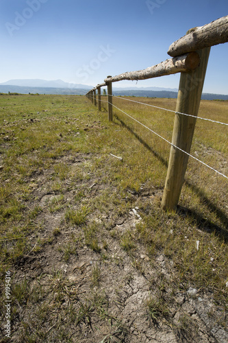 Fotografia, Obraz  Receding long fence on ranch, northern Jackson Hole, Wyoming, ve