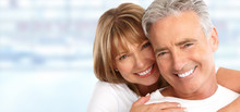 Elderly Couple With White Teeth.