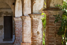Arched Columns Inside A Passageway In Mission San Juan Capistrano In California