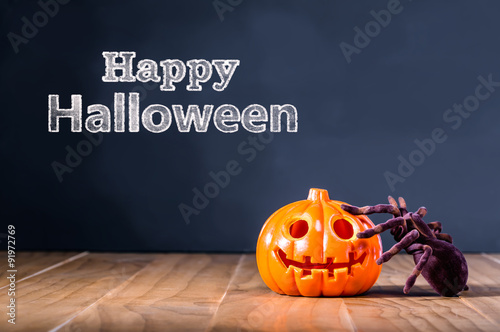 happy halloween message with pumpkin and spider buy this stock