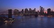 New York City Brooklyn Bridge downtown buildings skyline sunset evening