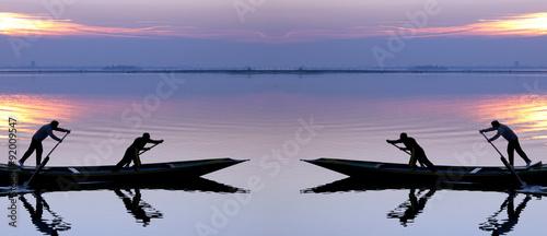 Fotografie, Obraz  Venice sunset silhouette of sinchronized rowing men