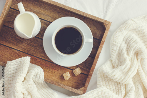 Stampa su Tela  cup of coffee, cream and brown sugar on wooden tray