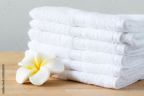 Fotografie, Obraz  Plumeria flower with stack of white towel