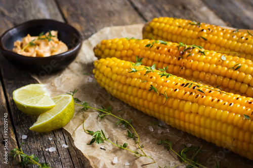 Canvas Print Grilled corn with garlic and chili butter