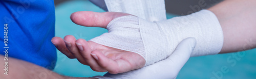 Bandage on wounded hand Fototapet